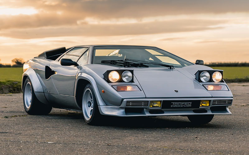 A Lambourghini Countach pictured against a moody sky to illustrate classic car finance solutions.